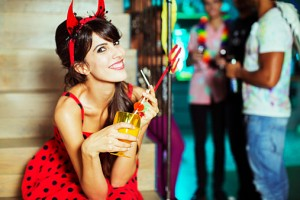 Woman wearing devil costume at party